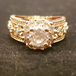 New Size 7 gold ring with white zircon